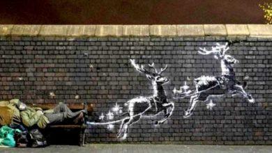 Photo of Il senzatetto di Banksy diventa il Babbo Natale simbolo di solidarietà